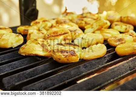 The Potatoes Are Barbecued Before The Festive Treat.