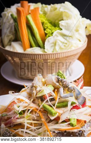 Thai Style Spicey Papaya Salad Served With Vegetables
