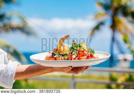 Hand With Shrimp Dish, Waiter Hand With Shrimp Dish