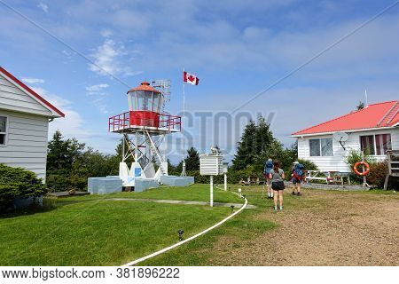 Cape Scott, British Columbia, Canada - July 31st, 2020: Hikers Visiting The Lighthouse At Cape Scott