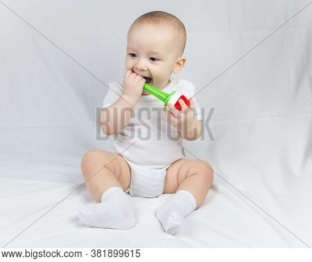 Image Of A Eight Month Old Baby With Rattle