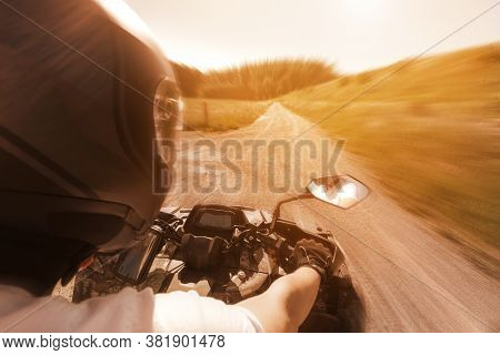 Atv Quad Rider Biker Drives With Helmet At High Speed Backview