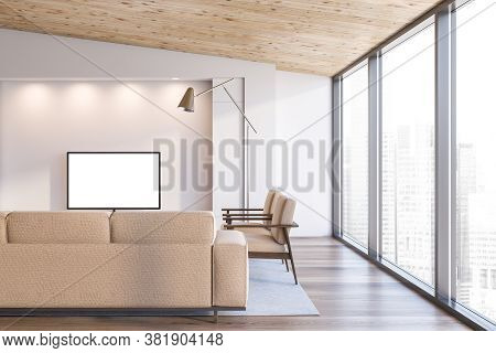 Interior Of Modern Living Room With White Walls, Wooden Ceiling, Beige Sofa And Armchairs And Mock U