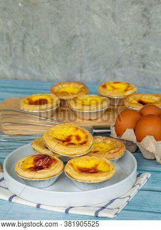 Dessert Egg Tart Or Portugal Egg Tart Sweet Custard Cream On White Dish And Blue Wooden Table With E