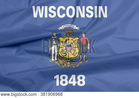 Fabric Flag Of Wisconsin. Crease Of Wisconsin Flag Background, The States Of America. Coat Of Arms O