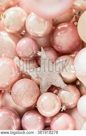 Macro Pink Christmas Toys Background. Preparing To Decorate Christmas Tree. New Year Decoration. Fes