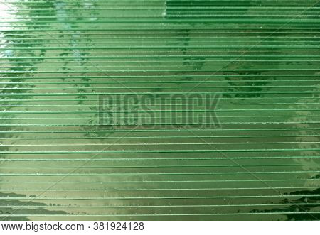 Glass Sheets In Horizontal Position. Texture Of Green Glass Sheets. Transparent Background From Butt