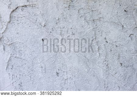 Textured Of Plastered Cement Wall Is Uneven Is Design And Concept For Background.