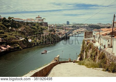 Beautiful View On River Douro With Riverboats Sailing, Old Town, Metal Arch Bridge And City Porto. P