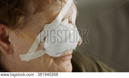 Portrait Of An Elderly Woman With The Eye Patch After The Cataract Surgery. Close Up.