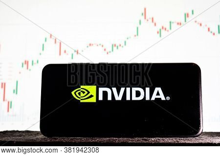 Tula, Russia - August 10, 2020: Logo Nvidia On A Smartphone Against The Background Of Stock Market T