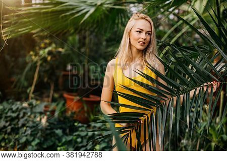 Pacified Sensul Caucasian Woman With Blonde Hair, Slim Body, Closed Eyes, Wearing Yellow Swimsuit, P
