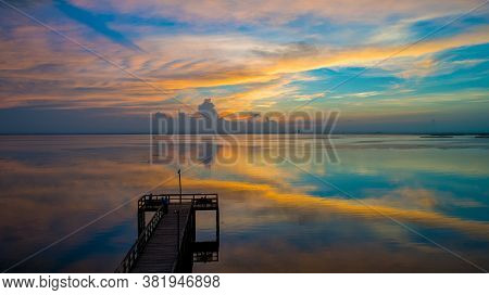 Mobile Bay Pier At Sunset On The Alabama Gulf Coast In July 2020