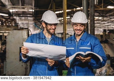 Happy Work. Factory Engineer With White Safety Helmet Smile And Relax Talk During Work On Production