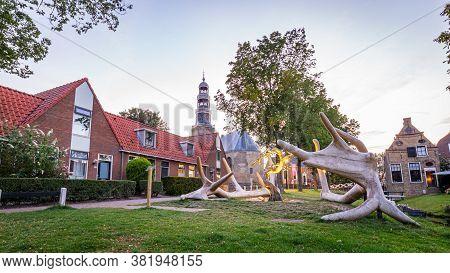 Hindeloopen, Friesland, Netherlands - August 6, 2020: Townscape With Bone Sculpture Village Hindeloo