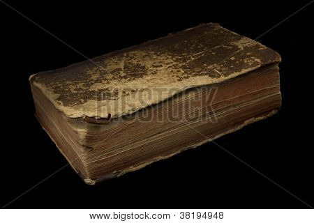 Ancient book on black background