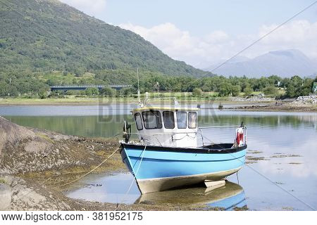 Blue Boat In Sea Water For Tranquility Calm Peace And Mindfulness In Argyll And Bute