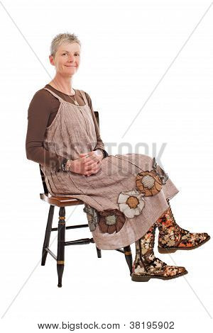 Smiling Older Woman In Flowered Boots Sits Sideways