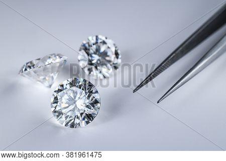Diamond Gemstone. Precious Loose Diamonds And Jewelry Tweezers