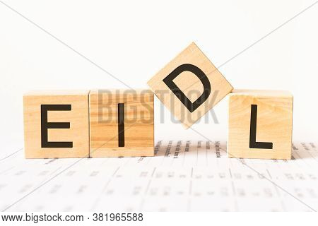 Word Eidl. Wooden Small Cubes With Letters Isolated On White Background With Copy Space Available.bu