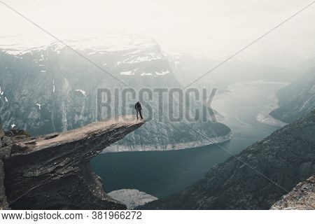 Woman On Trolltunga (Troll tongue) The Famous place in Norway, View On  Trolltunga And  Mountain Landscape, Odda, Norway