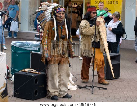 Skegness, England - Aug 23: Native Americam Indian Tribal Group Play Music, Sing And Dance To Entert