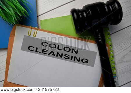 Colon Cleansing Text With Document Brown Envelope And Gavel Isolated On Office Desk.