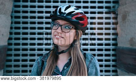 Portrait Of A Sportive Young Woman With Glasses Thinking While On Rollerblades. Urban Area. High Qua