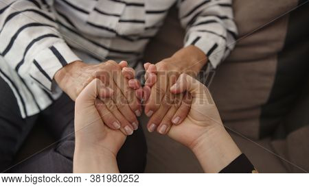 Empathy And Compassion For Elderly. Young Woman Holding Hands Of A Senior Lady. High Quality 4k Foot