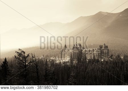 BANFF, AB, CANADA - SEP 4: Fairmont Hotel and mountain on September 4, 2015 in Banff, Canada. Fairmont hotel chain is known in Canada for its famous historic hotels and resorts