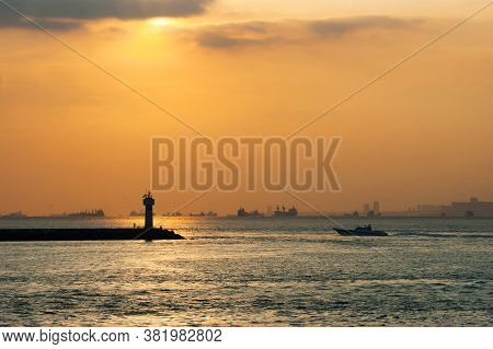 Lighthouse And Boat Silhouette With Sunset On Steamboat In İstanbul. Seascape Bosphorus Background