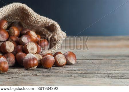 Hazelnuts, Filbert On Old Wooden Table. Heap Or Stack Of Hazel Nuts. Hazelnut Background, Healty Foo