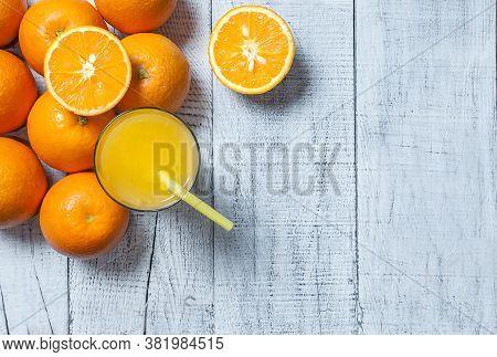 Freshly Squeezed Orange Juice In Glass With Orange Fruits On Wooden Background, Bitter Seville Fresh