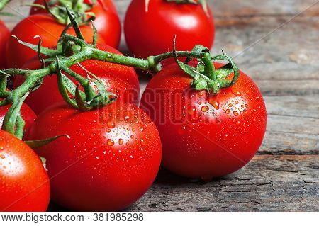 Ripe Fresh Grape Tomatoes Rustic Wooden Background. Cherry Tomato Vegetable Salad Concept