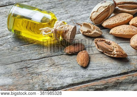 Sweet Almond Oil In Glass Of Bottle. Almonds Nuts And Oil Concept.great For Skin Health.almond In Nu