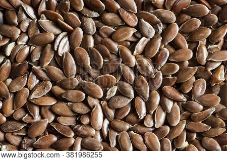 Heap Of Flax Seeds Or Linseeds Background. Flaxseed Or Linseed Concept. Flax Seed Dietary Fiber Back