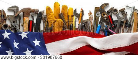 Patriotic collection of worn and used work tools with US American flag. Made in USA, American workforce, or Labor Day concept.