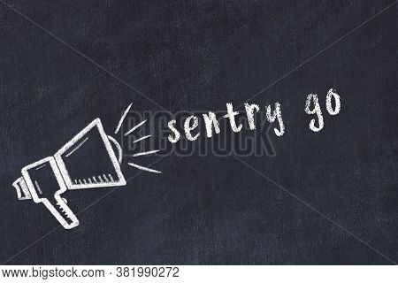 Black Chalkboard With Drawing Of A Loudspeaker And Inscription Sentry Go
