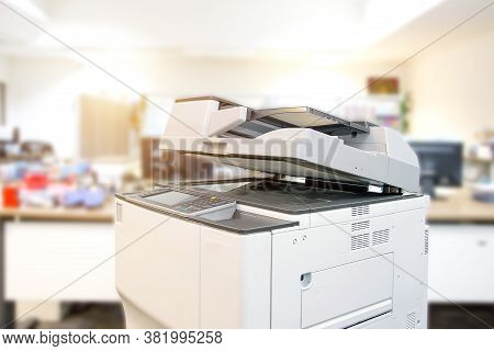 The Photocopier Or Xerox Printer Machine Is Office Work Tool Equipment In Copy Room For Scanning Doc