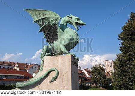 Ljubljana, Slovenia - August 13, 2020: Bronze Dragon On The Dragon Bridge - A Symbol Of Ljubljana