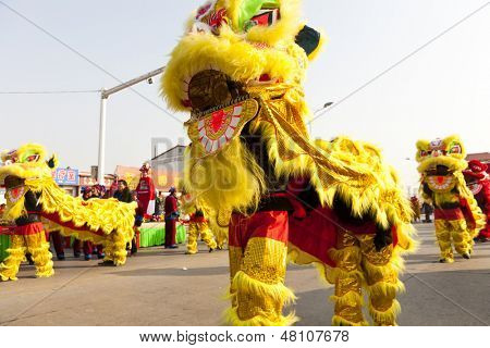 YU COUNTY CHINA  FEBRUARY 5: People performing traditional lion dance for celebrating Lantern Festival on February 11 2013 at Yu Couunty, China.