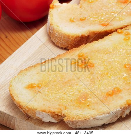 closeup of pa amb tomaquet, bread with tomato, typical of Catalonia, Spain
