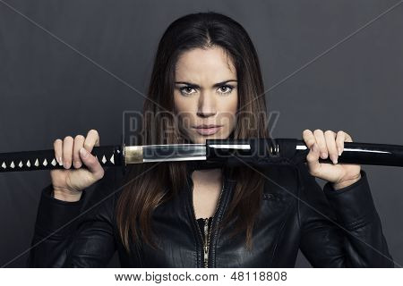 Portrait Of Beautiful Woman With Katana