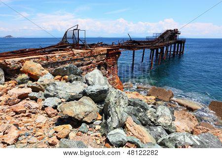 Iron ore on Island of Elba coast. Old abandoned mine nearby Rio Marina City. Toscana, Italy.