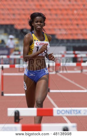 DONETSK, UKRAINE - JULY 11: Tia-Adana Belle of  Barbados compete in semi-final of 400 m hurdles during 8th IAAF World Youth Championships in Donetsk, Ukraine on July 11, 2013