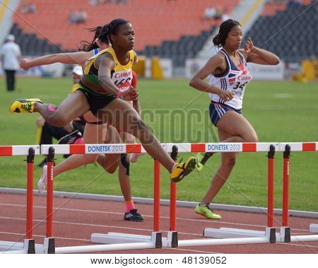 DONETSK, UKRAINE - JULY 11: Burton, Jamaica (left) and Irving, Great Britain compete in semi-final of 100 m hurdles during 8th IAAF World Youth Championships in Donetsk, Ukraine on July 11, 2013