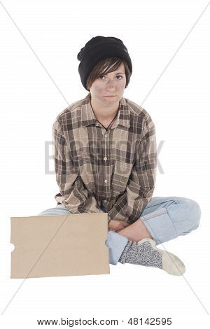 Young Homelessness Sitting With A Sign In Front Of Her
