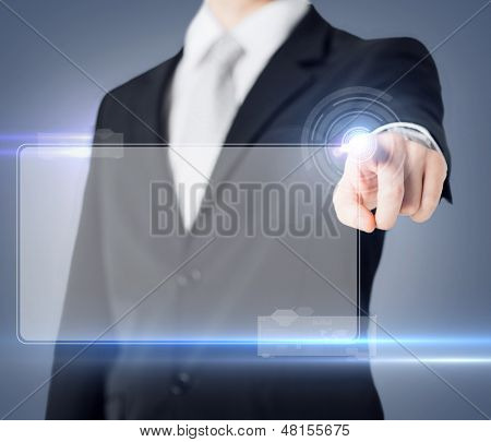 future technology and business concept - male hand touching virtual screen