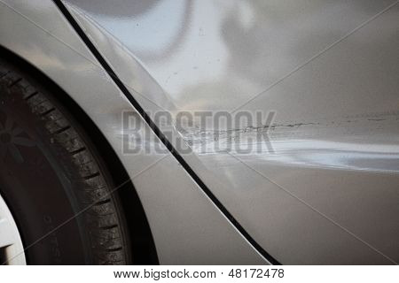 Side Panel And Wheel Of A Car