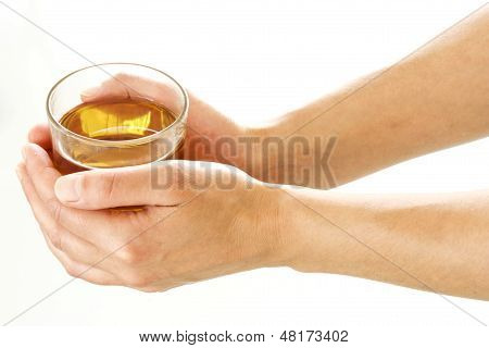 Woman Hands Holding A Glass Of Tea